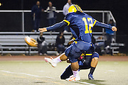 Milpitas High School junior kicker, Jesus Gonzalez (12), kicks an extra point after a touchdown during the Oct. 5, 2012, home game against Mountain View.  Milpitas High School would go on to win 42-7.  Photo by Stan Olszewski/SOSKIphoto.