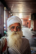 A muslim in Old Town in New Delhi, India. Turbans are not required of all Muslim men, but those who wear them do so for a variety of reasons. Perhaps the most important reason is in emulation of the Prophet Muhammad, who is believed to have worn either a white or a black turban.