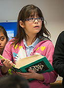 Students work on a project in Dr. Johnnie Carter's 4th grade writing class at De Anda Elementary School, February 5, 2014.
