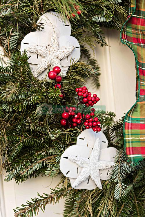 December 21, 2017 - Charleston, South Carolina, United States of America - Starfish and sand dollars decorate a Christmas wreath at a historic home on Tradd Street in Charleston, SC. (Credit Image: © Richard Ellis via ZUMA Wire)