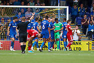 AFC Wimbledon goalkeeper Nathan Trott (1) being congratulated by team mates during the EFL Sky Bet League 1 match between AFC Wimbledon and Accrington Stanley at the Cherry Red Records Stadium, Kingston, England on 17 August 2019.
