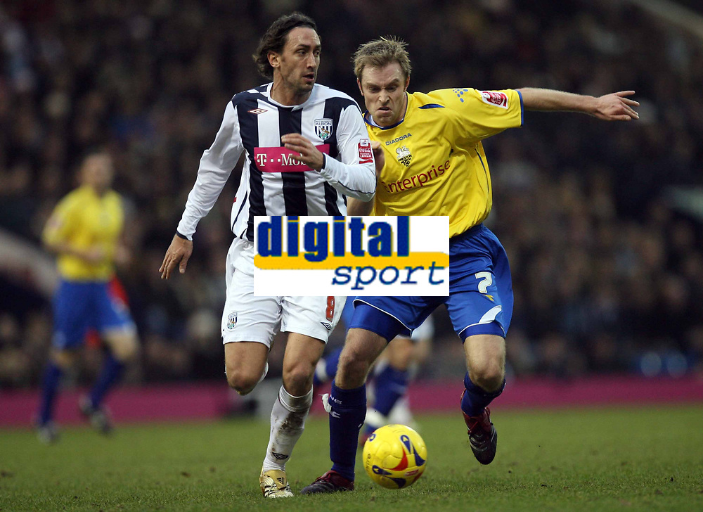 Photo: Rich Eaton.<br /> <br /> West Bromwich Albion v Preston North End. Coca Cola Championship. 26/12/2006. Jonathan Greening of West Brom left and Chris Sedgwick fight for the ball
