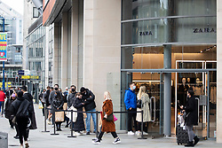 © Licensed to London News Pictures. 25/10/2020. Manchester, UK. Shoppers queue for Zara on Market Street, Manchester. Shoppers in Manchester aren't deterred by new tier 3 restriction or potential tier 4 restrictions, which could see retail and restaurants closed. Photo credit: Kerry Elsworth/LNP