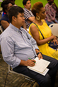 Jamaica, NY - 20 July 2017. Business plan presentations of the second cohort of the 12-week Jamaica FEASTS program at the Queens Public Library. Thi Ha Sam taking notes during a presentation.