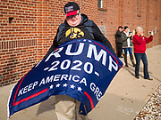 """09 NOVEMBER 2019 - DES MOINES, IOWA: A supporter of US President Donald Trump pickets a climate change town hall sponsored by Senator Bernie Sanders. Sanders and Rep. Congresswoman Alexandria Ocasio-Cortez (D-NY), hosted the """"Climate Crisis Summit"""" at Drake University in Des Moines. More than 2,000 people attended the event. Sanders, an independent, is running to be the Democratic nominee for the 2020 US Presidential election. Iowa holds the first in the country selection contest with state caucuses on Feb. 3, 2020.               PHOTO BY JACK KURTZ"""