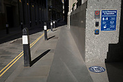 With the UK death toll reaching 34,813, with a further 541 victims in the last 24hrs, the government's pandemic lockdown has eased to another stage and a corporate office displays a social distance requirement notice on Throgmorton Street in the City of London, the capital's financial district, on 1st June 2020, in London, England.