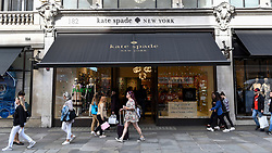 © Licensed to London News Pictures. 05/06/2018. LONDON, UK.  People walk by the exterior of the Kate Spade New York store on Regent Street, one of four stores in central London.  It has been reported that the designer Kate Spade (real name Katherine Noel Brosnahan) has been found dead in her New York apartment in an apparent suicide.  Photo credit: Stephen Chung/LNP