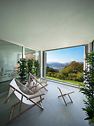 Interior of a modern house,balcony overlooking the lake
