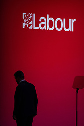 © Licensed to London News Pictures. 24/09/2021. Brighton, UK. Labour Party Leader SIR KEIR STARMER is seen in silhouette stepping off the auditorium stage of the Brighton Centre this evening (Friday 24th September 2021) ahead of the start of the Labour Party Conference . Photo credit: Joel Goodman/LNP