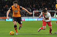 Hull City defender Harry Maguire (12) kakes headway up the field  during the Sky Bet Championship match between Hull City and Charlton Athletic at the KC Stadium, Kingston upon Hull, England on 16 January 2016. Photo by Ian Lyall.