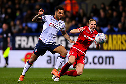Josh Magennis of Bolton Wanderers takes on Michael Dawson of Nottingham Forest - Mandatory by-line: Robbie Stephenson/JMP - 24/10/2018 - FOOTBALL - University of Bolton Stadium - Bolton, England - Bolton Wanderers v Nottingham Forest - Sky Bet Championship