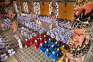 Monks lined up and praying in Tay Ninh 's Cao Dai Temple, Vietnam, Asia