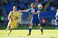 Sean Morrison of Cardiff city ® holds off Martyn Woolford of Millwall. Skybet football league championship, Cardiff city v Millwall at the Cardiff city stadium in Cardiff, South Wales on Saturday 18th April 2015<br /> pic by Andrew Orchard, Andrew Orchard sports photography.