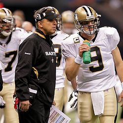 2009 October 18: New Orleans Saints quarterback Drew Brees (9) talks with head coach Sean Payton during during a time out in a regular season game between the New Orleans Saints and the New York Giants at the Louisiana Superdome in New Orleans, Louisiana.