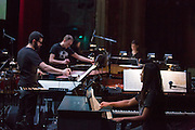 Brooklyn, NY - 20 January 2015. The dress rehearsal of Sufjan Stevens' Round-Up, with slow motion film of the Pendleton, Oregon Round-Up by Aaron and Alex Craig, music performd by Sufjan Stevens and Yarn/Wire. Musicians (L to R) Russell Greenberg, Ian Antonio, Laura Barger (in the background, piano), Ning Yu (piano).