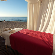 Oceanside massage table at the Westin Hotel with draperies blowing in the sea breeze. Mexico.