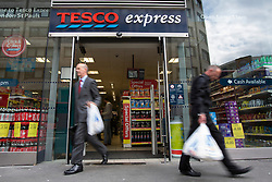 © licensed to London News Pictures. London, UK 03/10/2012. People walking past a Tesco store in central London on 03/10/12. Tesco sales at the UK stores are up by 0.1 per cent since August 25, 2012. Photo credit: Tolga Akmen/LNP