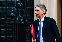 Downing Street, London, January 20th 2015. Ministers leave the weekly cabinet meeting at Downing Street. PICTURED: Foreign Secretary Philip Hammond.