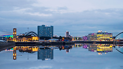 Evening skyline view of Glasgow across River Clyde towards Clydeside Distillery and BBC Scotland Headquarters  ,Scotland, United Kingdom