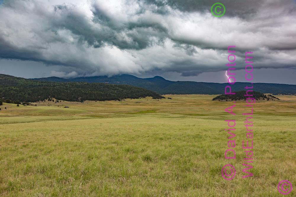 Lightning storm passes over Redondo Peak, with lightning striking beyond the ridge along the northwest side of the Valle Grande, Valles Caldera National Preserve, Jemez Mountains, New Mexico, © David A. Ponton