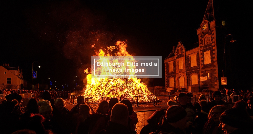 The Biggar Hogmanay bonfire lit at 9.30pm on Hogmanay by local resident Bobby Boyd MBE.<br /> <br /> This is probably the biggest new year bonfire anywhere in the UK and continues a tradition going back hundreds of years.<br /> <br /> <br /> (c) Andrew Wilson   Edinburgh Elite media