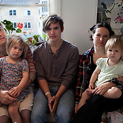 Södra Station co-housing in Stockholm,  Sweden August 29, 2012. <br /> Johan and Emma Holmer with their son Paul and their little daughters Bella and Liora.<br /> Holmer family has moved to Sodra Station in the summer of 2012 and it was their first collective living experience.