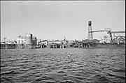 "Y-590824B-15. ""trip in Harbor Patrol boat on Portland Waterfront"". Albina Engine & Machine Works, Permanente Cement Dock. August 24, 1959"