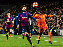 BARCELONA, March 14, 2019  Barcelona's Gerard Pique (C) vies with Lyon's Ferland Mendy (R) during the UEFA Champions League match between Spanish team FC Barcelona and French team Lyon in Barcelona, Spain, on March 13, 2019. Barcelona won 5-1 and advanced to the quarterfinals. (Credit Image: © Joan Gosa/Xinhua via ZUMA Wire)