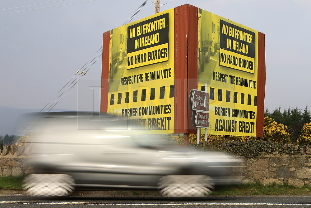 © London News Pictures. 28/03/2017. A car crosses the border from the Irish Republic to Northern Ireland close to an anti Brexit billboard, Wednesday 28th, March, 2017. Britian's Prime Minister Theresa May will trigger Article 50 tomorrow (Weds). Photo credit: Paul McErlane/LNP