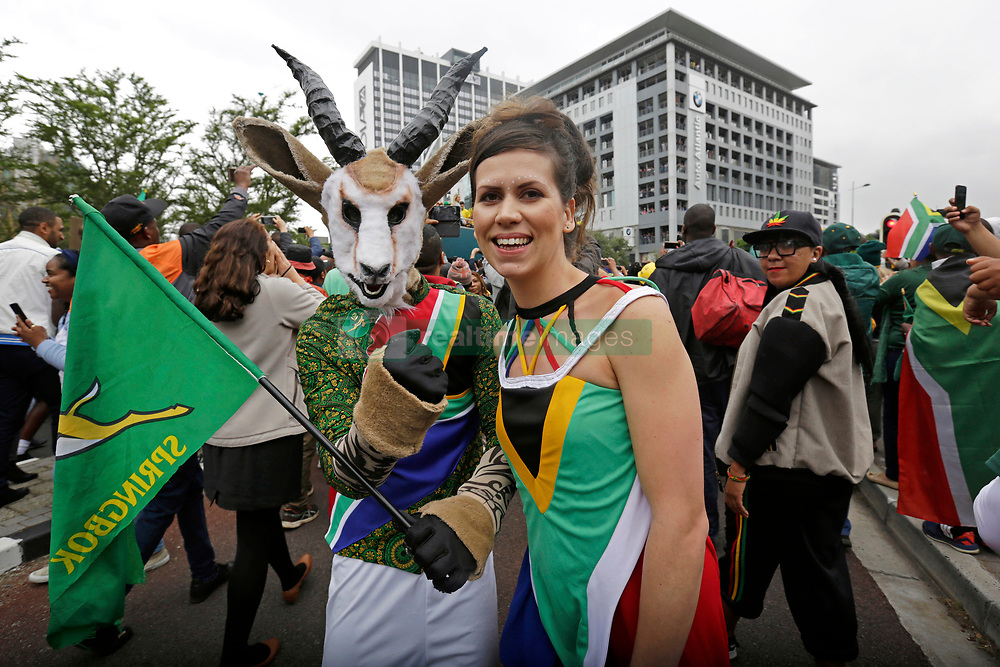 Monday 11th November 2019.<br /> City Hall, Grand Parade,<br /> And City Centre, Cape Town,<br /> Western Cape,<br /> South Africa.<br /> <br /> SPRINGBOKS CELEBRATE WINNING THE RUGBY WORLD CUP CHAMPIONSHIP IN 2019 WITH A COUNTRYWIDE VICTORY TOUR!<br /> <br /> SPRINGBOKS RUGBY WORLD CUP VICTORY TOUR CAPE TOWN!<br /> <br /> An excited female fan wearing a South African flag outfit stands with a friend dressed up as a Springbok as they celebrate along with many others while the Springboks drive past in their open top bus in the Cape Town City Centre.<br /> <br /> The reigning Rugby World Cup Champions namely the South African Springbok Rugby Team, celebrates winning the Webb Ellis Cup during the International Rugby Football Board Rugby World Cup Championship held in Japan in 2019 with their Victory Tour that culminated in the final city tour taking place in Cape Town. Thousands of South African fans filled the streets of the city all trying their best to show their support for their beloved Springboks and to celebrate them winning the Rugby World Cup for the third time. South Africa previously won the Rugby World Cup in 1995, 2007 and now again in 2019. South African Springbok Captan Siya Kolisi took the opportunity to speak to the gathered crowd about how something like this brings unity and that we should live together as a nation that practices what is known as ubuntu. Ubuntu is a quality that includes the essential human virtues of compassion and humanity. This image taken in Cape Town on Monday 11th November 2019.<br /> <br /> This image is the property of Seven Bang Media Group (Pty) Ltd, hereinafter referred to as SBM.<br /> <br /> Picture By: SBM / Mark Wessels. (11/11/2019).<br /> +27 (0)61 547 2729<br /> mark@sevenbang.com<br /> www.sevnbang.com<br /> <br /> Copyright © SBM. All Rights Reserved.