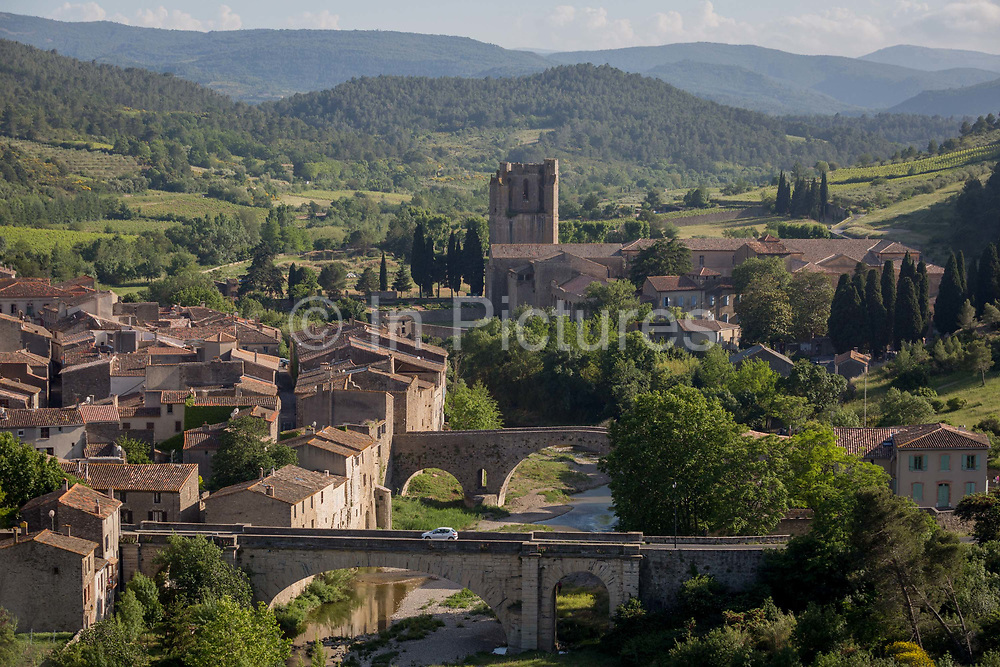 Aerial landscape overlooking the pretty French medieval walled village of Lagrasse and the tower of the Abbey of Sante-Marie DOrbieu, on 23rd May, 2017, in Lagrasse, Languedoc-Rousillon, south of France. Lagrasse is listed as one of Frances most beautiful villages and lies on the famous Route 20 wine route in the Basses-Corbieres region dating to the 13th century.