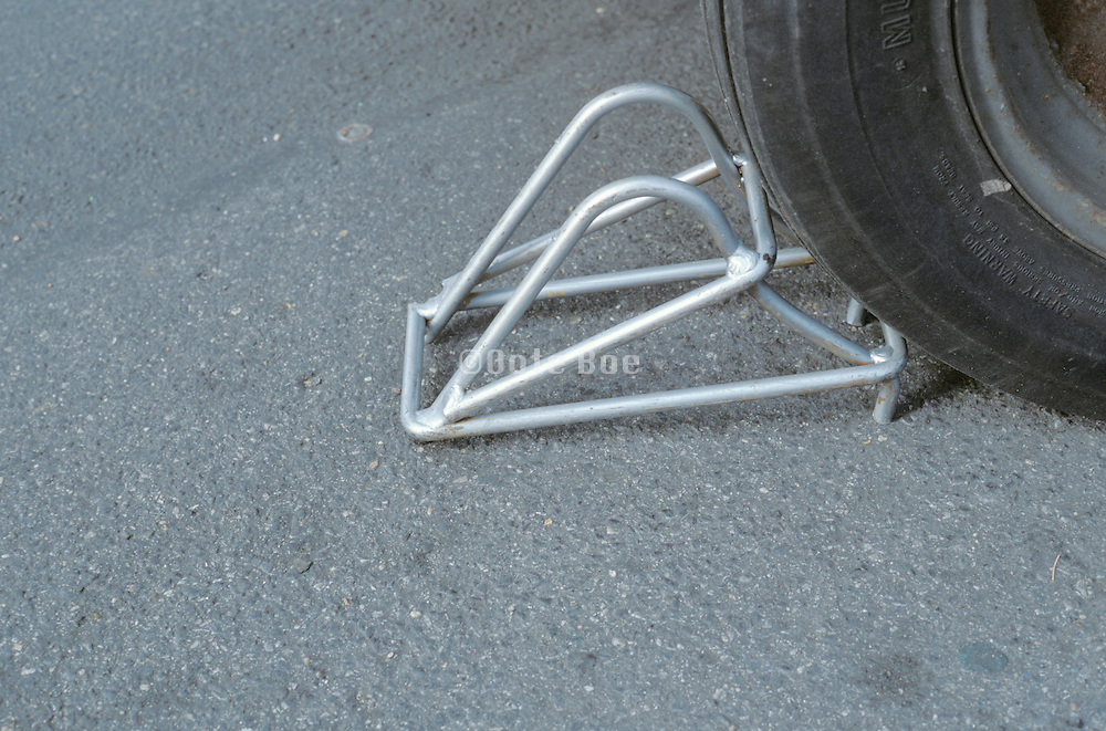 close up of tire and tire stopper