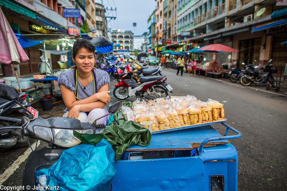 22 OCTOBER 2012 - HAT YAI, THAILAND:      A vendor sells fried snacks in the market in Hat Yai, Thailand. Hat Yai is the largest in southern Thailand. It is an important commercial center and tourist destination. It is especially popular with Malaysian, Singaporean and Chinese tourists.     PHOTO BY JACK KURTZ
