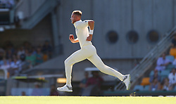 England's Stuart Broad bowls during day two of the Ashes Test match at The Gabba, Brisbane.