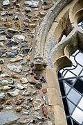 Village parish church Cratfield, Suffolk, England, UK carved stone face