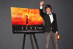 London, June 23rd 2014. Jose Luis Gutierrez Real who stars as a young Seve mimmics the film's poster at the premiere of the film Seve, a biopic of the life of the legendary Spanish golfer Seve Ballesteros.