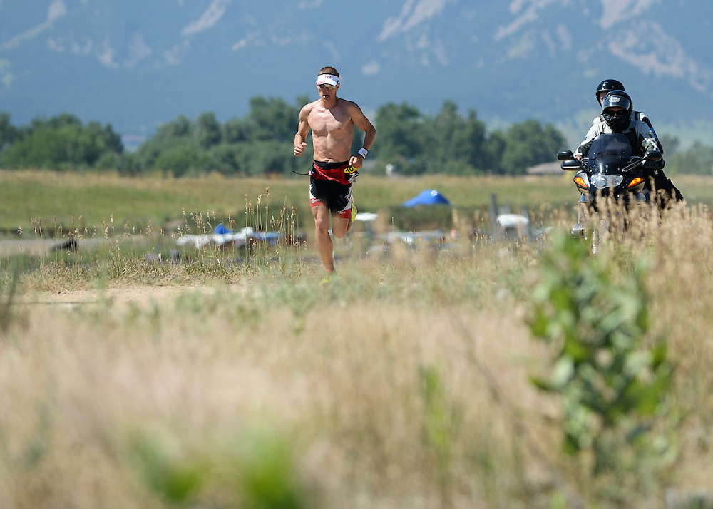 Male pro Matt Chrabot on the run course during the 2014 Boulder Peak Triathlon.