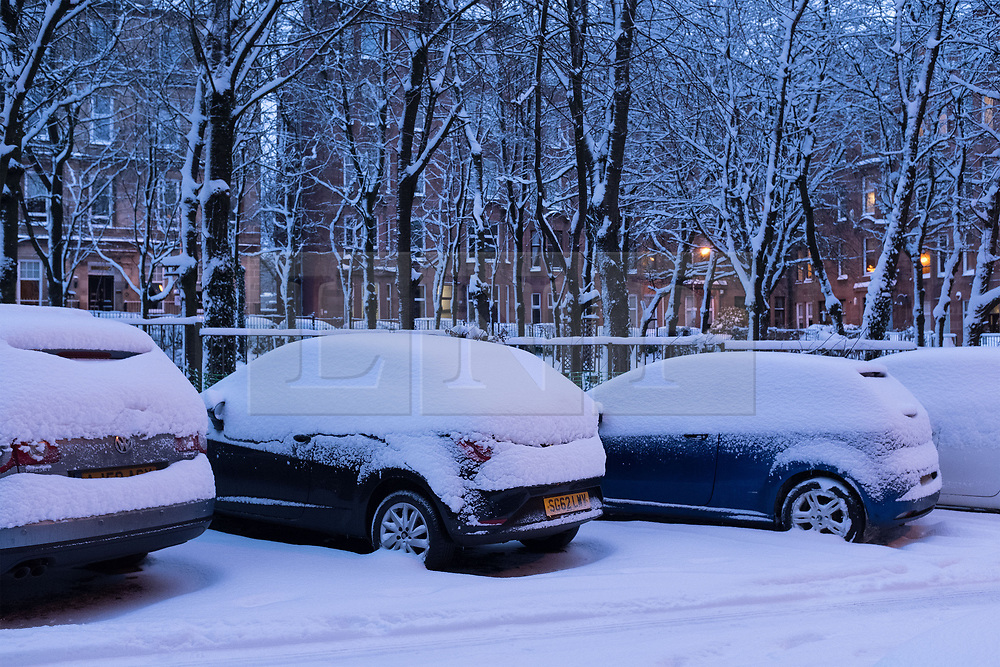 """© Licensed to London News Pictures. 28/02/2018. <br /> <br /> Heavy snow on top of cars in Springhill Gardens, Shawlands, Glasgow, Scotland as the city hit with snow storm """"Beast from the East"""" on 28th February 2018.<br /> <br /> Photo credit should read Max Bryan/LNP"""