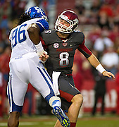 Arkansas Razorbacks quarterback Tyler Wilson (8) is roughed up by Kentucky Wildcats defensive end Collins Ukwu (96) following a pass during the first half of a game at Donald W. Reynolds Razorback Stadium in Fayetteville, Ark., on Oct.. 13, 2012. Photo by Beth Hall