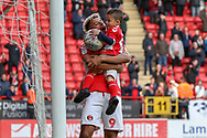 Charlton Athletic attacker Lyle Taylor (9) celebrating with his nephew during the EFL Sky Bet League 1 match between Charlton Athletic and Rochdale at The Valley, London, England on 4 May 2019.