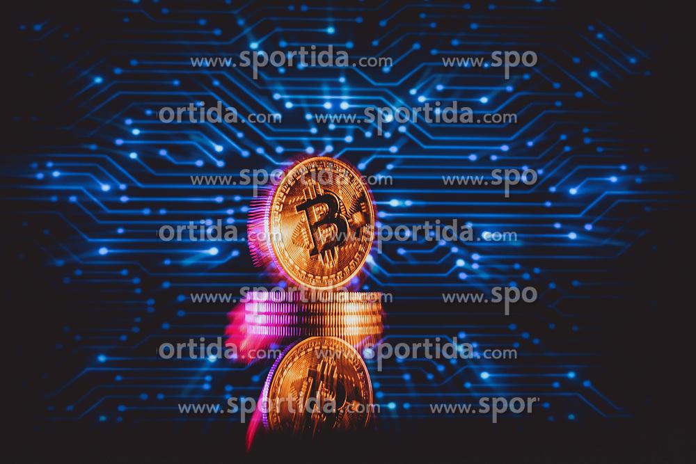 THEMENBILD - Bitcoin Münzen. Bitcoin ist eine Kryptowährung auf Basis eines dezentral organisierten Buchungssystems. Zahlungen werden kryptographisch legitimiert und über ein Netz gleichberechtigter Rechner abgewickelt. Anders als im klassischen Banksystem üblich ist kein zentrales Clearing der Geldbewegungen notwendig, aufgenommen am 11. März 2021 in Österreich // Bitcoin is a cryptocurrency based on a decentrally organized booking system. Payments are cryptographically legitimized and processed via a network of computers with equal rights. Unlike in the classic banking system, no central clearing of money movements is necessary, taken on 2021/03/11 in Austria. EXPA Pictures © 2021, PhotoCredit: EXPA/ JFK