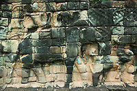 The Terrace of the Elephants is part of the walled city of Angkor Thom, The terrace is named for the carvings of elephants on its eastern face.  The Terrace of Elephants was used as a giant reviewing stand for public ceremonies and served as a base for the king's grand audience hall. The middle section of the retaining wall is decorated with life size garuda and lions; towards either end are the two parts of the famous parade of elephants complete with their Khmer mahouts.