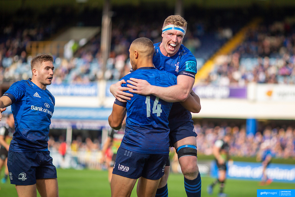 DUBLIN, IRELAND:  October 9:  Adam Byrne #14 of Leinster is congratulated by Dan Leavy #6 of Leinster after scoring his second try of the match during the Leinster V Zebre, United Rugby Championship match at RDS Arena on October 9th, 2021 in Dublin, Ireland. (Photo by Tim Clayton/Corbis via Getty Images)
