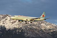 Air Canada Embraer 190 landing in the sunset
