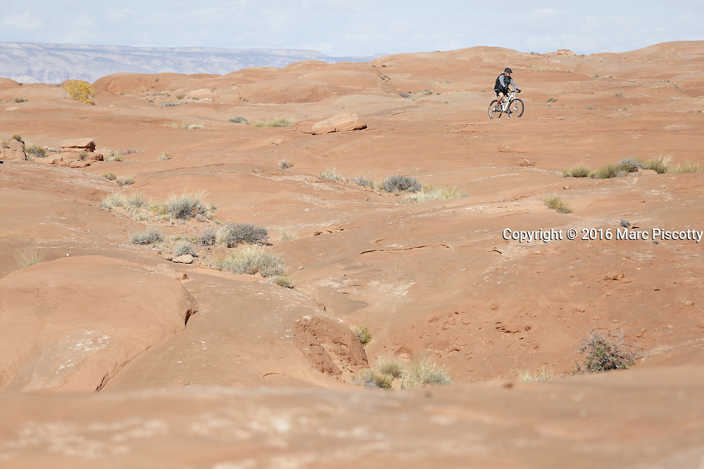 SHOT 10/18/16 11:08:08 AM - Emery County Utah tourism photos including hiking and exploring Goblin Valley including an arch rappel, the Black Dragon Canyon and  mountain biking Saucer Basin with Lamar Guymon. (Photo by Marc Piscotty / © 2016)