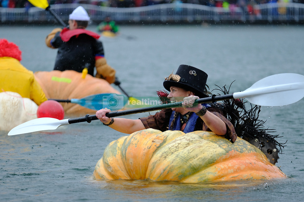 Charity Marshall prepares to race a giant pumpkin across Lake of the Commons at the 14th annual West Coast Giant Pumpkin Regatta in Tualatin, Ore. on October 21, 2017. (Photo by Alex Milan Tracy)
