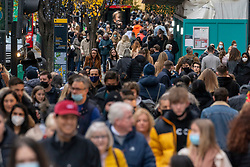 © Licensed to London News Pictures. 12/12/2020. London, UK. Christmas shoppers in Oxford Street on a busy Saturday afternoon. London is currently under Tier 2 Covid restrictions and could be facing Tier 3 as the Covid-19 case rate has been the highest in the UK. Photo credit: Ray Tang/LNP