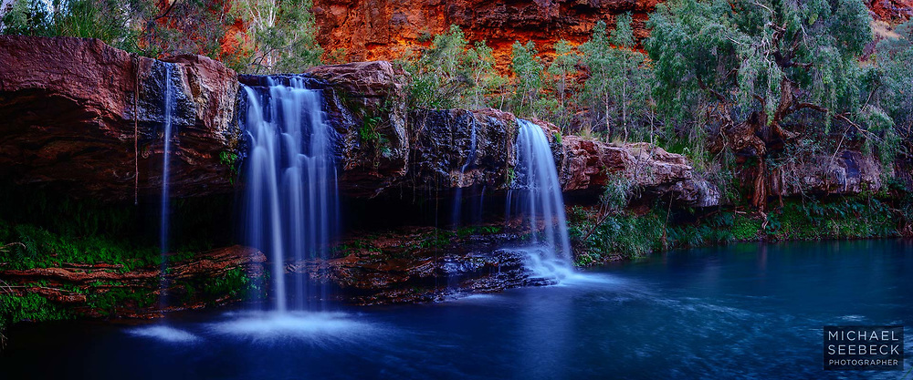 Waterfalls flowing into a turquoise pool, captured at dawn in the Pilbara of Western Australia; a haven for life in arid country.<br /> <br /> Limited Edition print
