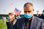 17 SEPTEMBER 2020 - DES MOINES, IOWA: INSANULLAN ANWARY, originally from Afghanistan, during a naturalization ceremony at Principal Park, a minor league baseball stadium in downtown Des Moines. About 75 people from 32 countries were naturalized as US citizens Thursday. It was the last citizenship ceremony in Des Moines before citizenship fees dramatically increase. Starting Oct. 2, the fee to apply for U.S. citizenship will increase from $640 to $1,160 if filed online, or $ 1,170 in paper filing, a more than 80% increase in cost. Advocates for immigration are afraid the new fees will be too expensive for many immigrants and say it's an effort by the Trump Administration to limit the number of new citizens welcomed into the United States. Because of the COVID-19 pandemic, there has been dramatic slow down in the number of naturalization ceremonies this year.         PHOTO BY JACK KURTZ