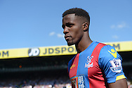 Wilfried Zaha of Crystal Palace looking on before k/o. Barclays Premier league match, Crystal Palace v Aston Villa at Selhurst Park in London on Saturday 22nd August 2015.<br /> pic by John Patrick Fletcher, Andrew Orchard sports photography.